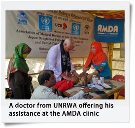 A doctor from UNRWA offering his assistance at the AMDA clinic