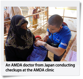 An AMDA doctor from Japan conducting checkups at the AMDA clinic