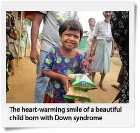 The heart-warming smile of a beautiful child born with Down syndrome